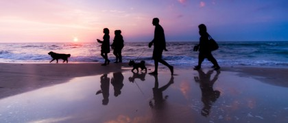 bigstock-Family-walk-on-the-beach-at-su-18950786