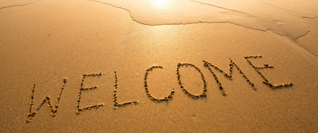 Texture on the sand: inscription Welcome